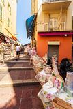 Narrow street in old part of Nice. Stock Photos