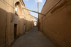 Narrow street of old part Yazd city. Stock Images