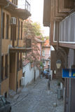 Narrow street of old Plovdiv in Bulgaria Royalty Free Stock Images