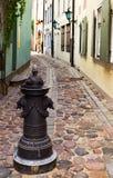 Narrow Street in old Riga city stock photography