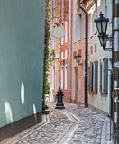 Narrow street in old Riga city, Latvia, Europe Royalty Free Stock Photography