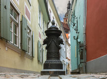 Narrow street in old Riga city, Latvia Royalty Free Stock Photo