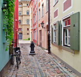 Narrow street in old Riga, Latvia Royalty Free Stock Image