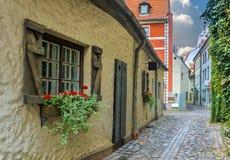 Narrow street in old Riga, Latvia Stock Photos