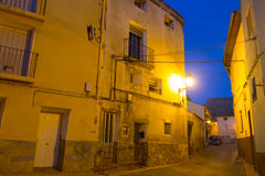 Narrow street at old spanish town in evening Royalty Free Stock Images