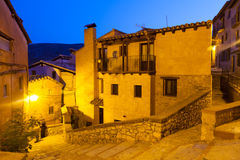 Narrow street of old spanish village in summer night Stock Photos
