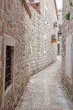 Narrow street of old stone city Royalty Free Stock Image