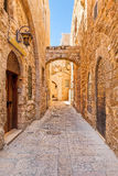 Narrow street among old stone walls of Jewish Quarter in Jerusal Royalty Free Stock Images