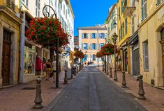Narrow street in Old Town of Antibes, France. Royalty Free Stock Photo