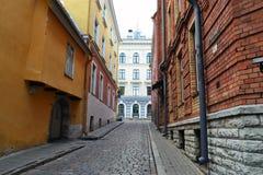 Narrow street in old town of Tallinn. Beautiful view of one of the narrow streets in the old town of Tallinn, Estonia Royalty Free Stock Image