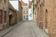 Narrow street old town of Brugge - Belgium. Stock Photos