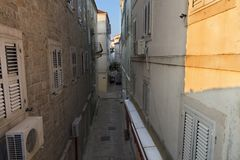 Narrow street of the old town of Budva in Montenegro. The old town of Budva in Montenegro, early morning, the sun creeps on a narrow street Royalty Free Stock Photography