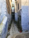 Narrow street in old town Chefchaouen stock images