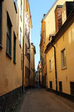 Narrow street in Old town in Stockholm Stock Photos