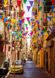 Narrow street in old town of Naples city in Italy Stock Images