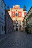 Narrow street of the old town in Poznan, near a baroque parish c royalty free stock photo