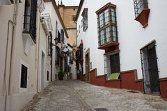 Narrow Street in Old Town of Ronda in Spain Royalty Free Stock Photo