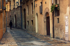 Narrow street in the old town , Spain Stock Photos