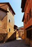 Narrow street of old town in summer Royalty Free Stock Photo