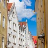 Narrow street in the old town of Tallinn city. Fascinating view of a narrow street in the old town of Tallinn city Royalty Free Stock Photography