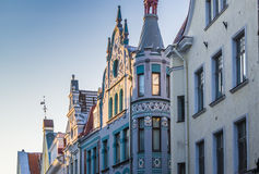 Narrow street in the Old Town of Tallinn with colorful facades Stock Images