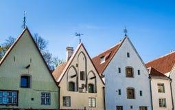 Narrow street in the Old Town of Tallinn with colorful facades. Estonia Stock Photos