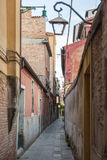 Narrow street in the old town in Venice Stock Image