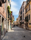 Narrow street in the old town in Venice Italy Royalty Free Stock Image