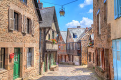 Narrow street with old traditional houses in Dinan Stock Photos
