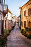 Narrow street old traditional houses village. With flowers, Alcudia, Majorca island, Spain Royalty Free Stock Photography