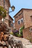 Narrow street old traditional houses village, Majorca island. Narrow street old traditional houses village with flowers, Fornalutx, Majorca island Stock Image