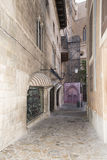 Narrow street in Palma de Mallorca. Spain. The Old City (in the south-east area of Palma behind the cathedral) is a fascinating maze of streets clearly hinting Royalty Free Stock Photo