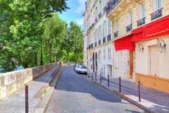 Narrow street in Paris, France. Stock Images