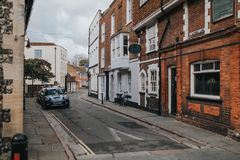 Narrow street with parked cars and traditional architecture in the village of Canterbury, Kent, England stock photo