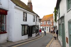 Narrow street through Rye in East Sussex. A narrow street passing through the town of Rye in East Sussex, England royalty free stock image