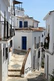 Narrow street and path in Frigiliana, Spanish white village Andalusia. Beautiful and charming with its narrow streets and paths white village Frigiliana, close Stock Photography