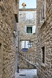 Old stone houses with windows with shutters in Budva in Monteneg stock photos