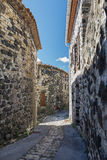 The narrow street in the picturesque village of Mirabel. Stock Photo