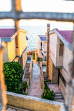 Narrow street of the port city leading to sea Royalty Free Stock Image