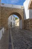 Narrow street in Portugal Stock Images
