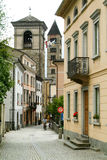 Narrow street of Poschiavo on the Swiss alps Royalty Free Stock Images