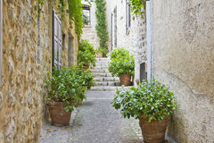 Narrow street in Provence Stock Images