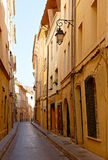 Narrow street with Provence houses Royalty Free Stock Images