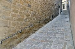 Narrow street railing Stock Photos