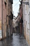 Narrow street in the rainy day. Beautiful narrow street in the rainy day Stock Photos