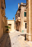 The narrow street and residential houses of Mdina, the old capit Stock Photography