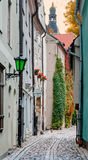 Narrow street in Riga city, Latvia. Riga is the capital of Latvia and famous Baltic city of medieval and Gothic architecture Stock Photography