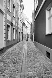 Narrow street in Riga old town in autumn Stock Photos