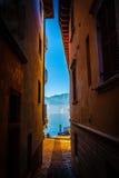 Narrow street 's aperture at Lake Garda Royalty Free Stock Photography