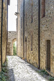Narrow street in San Quirico Royalty Free Stock Photos